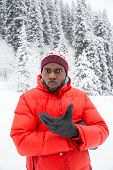 African American Cheerful Black Man In Ski Suit In Snowy Winter Outdoors, Almaty, Kazakhstan, Asia