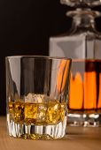 foto of malt  - Single malt whisky on the rocks and carafe in background - JPG