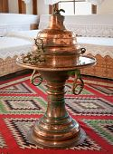 GJIROKASTER, ALBANIA-JUNE 7, 2014 : Vintage metal teapots in  traditional Albanian house on June 7,