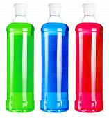 Bottles with colorful liquid soap