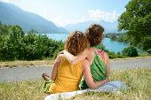 image of same sex  - two lesbians in nature admire the lake of Annecy - JPG