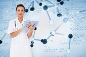 Pretty nurse using tablet pc against notes of biotechnology and genes
