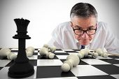 Composite image of focused businessman with chessboard