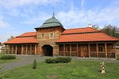 Ukrainian wooden house with red tile roof in National Historic and Architectural Complex
