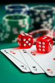 foto of dice  -  the red casino dice and poker cards on green table - JPG