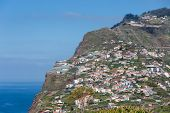 Madeira Island With Houses Built At A Cliff