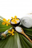 Spa set with spa oil ,towel salt in bowl ,yellow orchid on palm leaf