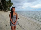 picture of filipina  - Filipina on a white sand beach before the rain - JPG