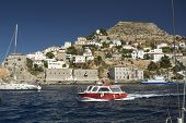 HYDRA, GREECE - MAY 7, 2014: Marina of Hydra Island. Donkeys are the only means of transport on the