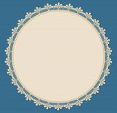 Beige Round Frame With Lacy Side On Blue Background.