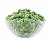 Frozen green peas in glass bowl.