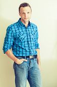 Portrait Of Young Caucasian Man In Blue Checkered Shirt. Instagram Effect