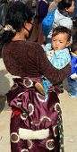 Tibetan woman carrying her child