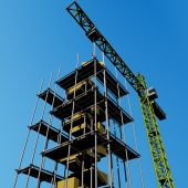 picture of jenga  - An unfinished building with scaffolding and a crane - JPG