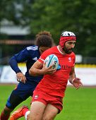 MOSCOW, RUSSIA - JUNE 28, 2014: Tedore Zibzibadze of Georgia with the ball in the match with France during the FIRA-AER European Grand Prix Series. Georgia won 31-14