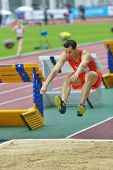 ZHUKOVSKY, MOSCOW REGION, RUSSIA - JUNE 27, 2014: Karol Hoffmann of Poland performs triple jump duri