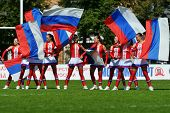 MOSCOW, RUSSIA - JUNE 29, 2014: Dancers with Russian flags supports the team Russia before the match for place 5 with Wales during the FIRA-AER European Grand Prix Series. Wales won 24-12