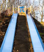 A childrens' play slide with Pi symbol.