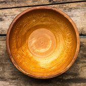 Ceramic Bowl On Wood Background. Top View