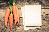 picture of recipe card  - Warm color toned series of Vegetables with recipe book on wooden table - JPG
