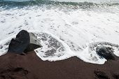 Black Sand And The Wave On The Seacoast