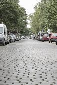 Cobblestone Road With Cars In Berlin Kreuzberg