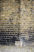 Edge Of An Old Brick Wall With Pavement For Backgrounds