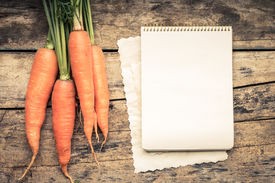 foto of recipe card  - Warm color toned series of Vegetables with recipe book on wooden table - JPG