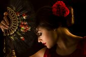 stock photo of drama  - Spanish girl dressed as a flamenco dancer - JPG