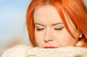 Beauty Face Red Hair Woman In Warm Clothing Outdoor