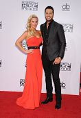LOS ANGELES - NOV 23:  Luke Bryan & Caroline Boyer arrives to the 2014 American Music Awards on November 23, 2014 in Los Angeles, CA