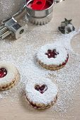 image of linzer  - Raspberry Linzer cookies on a wooden work bench - JPG