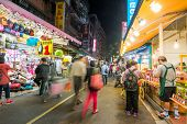 TAIPEI, TAIWAN - November 21th : Llively old streets at night in Tamsui with people, Taiwan on November 21th, 2014.