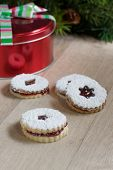 stock photo of linzer  - Raspberry Linzer cookies on a wooden work bench - JPG