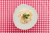 Gnocchi plate on Red and white checkered table