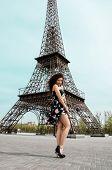 Woman in dress, near the Eiffel Tower
