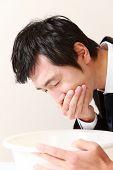 vomiting businessman