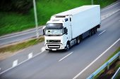pic of moving van  - large van with load moves along road - JPG