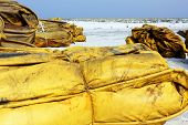 Containment Boom On White Sand Beach Ready For Oil Spill Cleanup