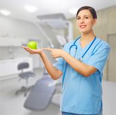 Doctor with green apple at medical office