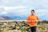 Sport running man in cross country trail run. Male runner exercising and training outdoors in beautiful mountain nature landscape on Snaefellsnes, Iceland.