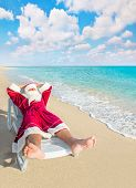 Santa Claus Have A Rest In Chaise Longue On Sea Beach