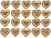 Heart shape christmas gingerbread cakes arranged on white background