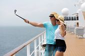 adorable couple taking self portrait on cruise