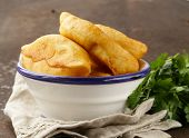 homemade fried pies with potatoes, rustic style
