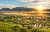 Sun Star Over Mountains With Misty Bog