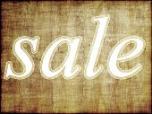 Sale Tag On Grunge Wooden Background.