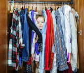 Cute Little Girl Hiding Inside Wardrobe From Her Parents