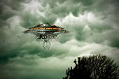 picture of flying saucer  - unidentified flying object flying over a tree - JPG