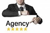 Businessman Pointing On Sign Agency Isolated